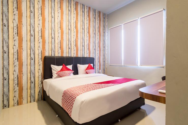 OYO 360 Mangaan Residence Medan - Bed Room