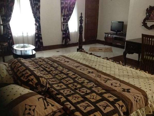 Aries Biru Hotel Bogor - Kamar tidur