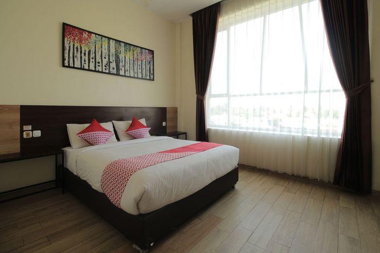 OYO 1017 Regency Hotel Pringsewu - Bedroom