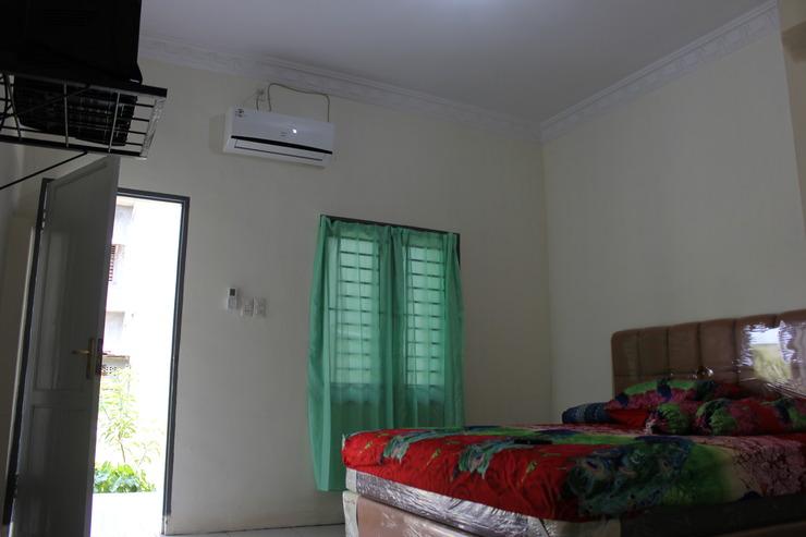 Penginapan Transit Tomato Deli Serdang - Bedroom