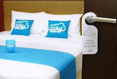 Airy Citraland International Surabaya - Bedroom