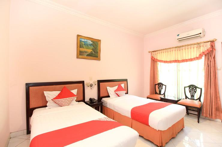 OYO 233 Hotel Global Inn Surabaya - Bedroom