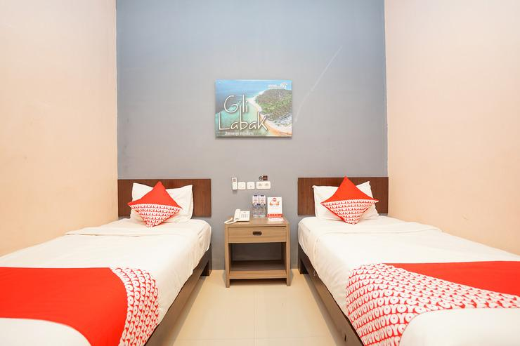 OYO 240 Audah Sevana Syariah Hotel Surabaya - BEDROOM