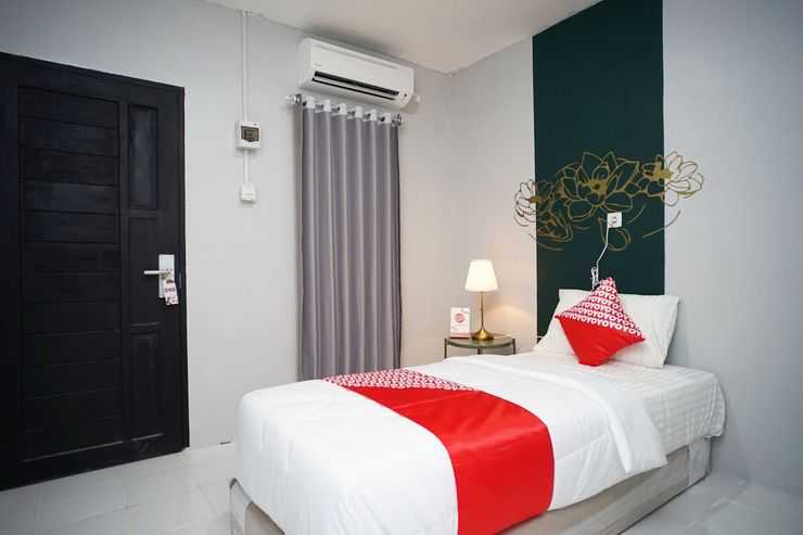 OYO 1125 Sani Guest House Balikpapan - Bedroom