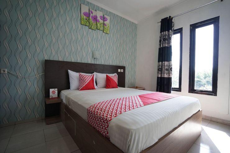 OYO 1266 Green Palm Kostel Syariah Lubuklinggau - Bedroom