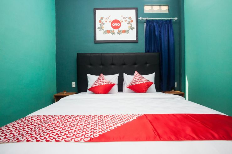 OYO 1052 Sentosa Jaya Guest House Medan - Bedroom