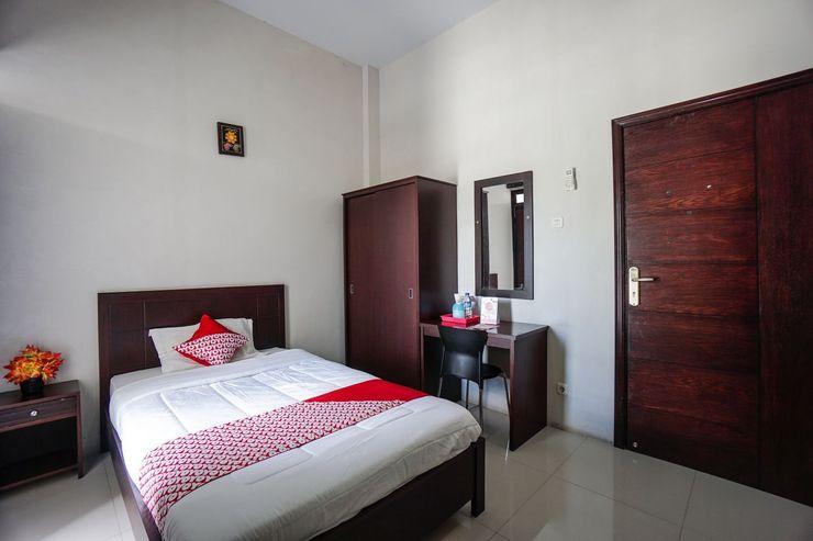 OYO 1236 Elite Residence Manado - Bedroom