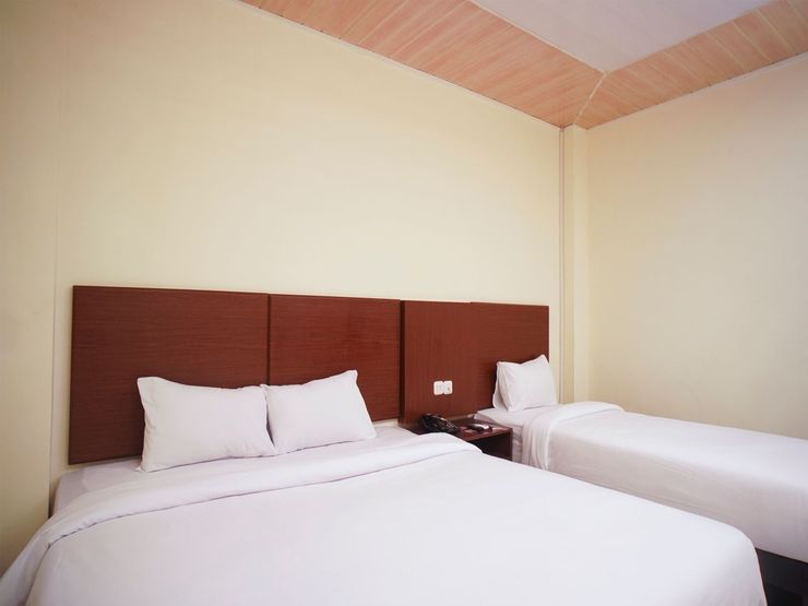 Hotel Winer Palembang - Bedroom
