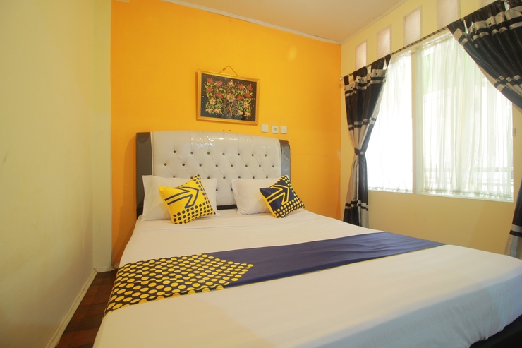 SPOT ON 1587 Graha Homestay Payakumbuh - Bedroom