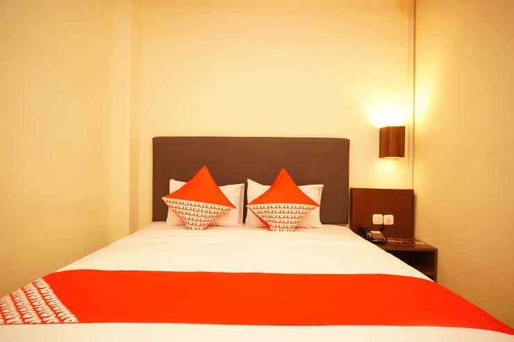 OYO 147 Hotel Winer Palembang - Bedroom