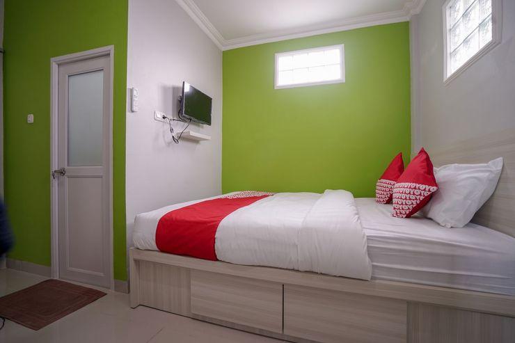 OYO 948 Vivi Residence Syariah II Palembang - Bedroom