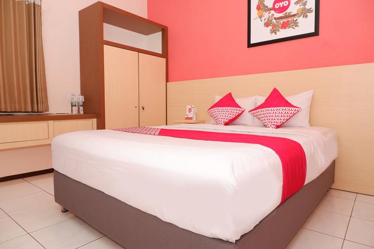 OYO 546 New Mira Hotel Semarang - Bedroom