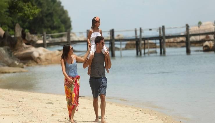Turi Beach Resort Batam - Family walking on the Beach