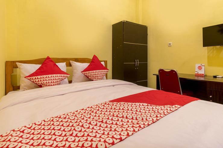 OYO 447 Hutasimo Residence Medan - Bedroom