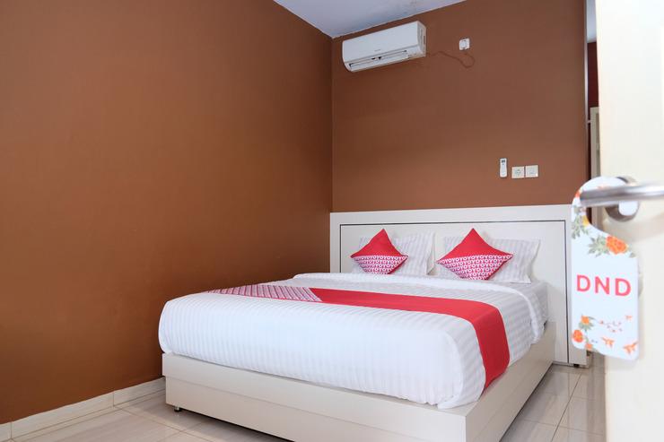 OYO 811 Mars Kost Syariah Jambi - Bedroom