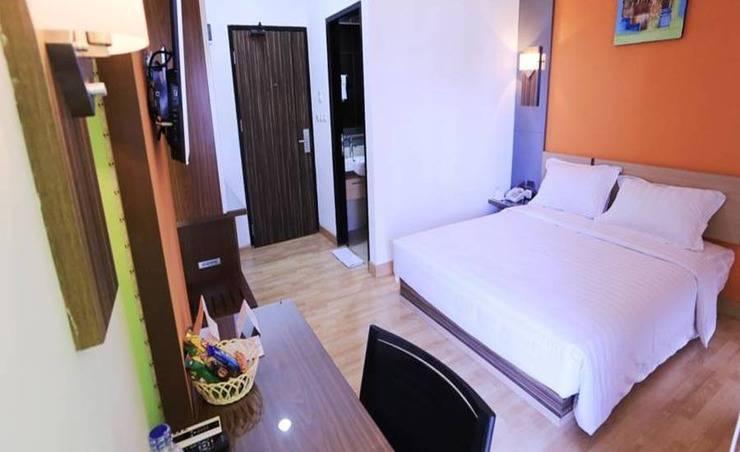 De' Nearby Hotel Manado - Kamar tamu