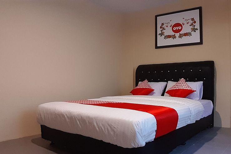OYO 1053 Angelyn Home Stay Medan - Bedroom