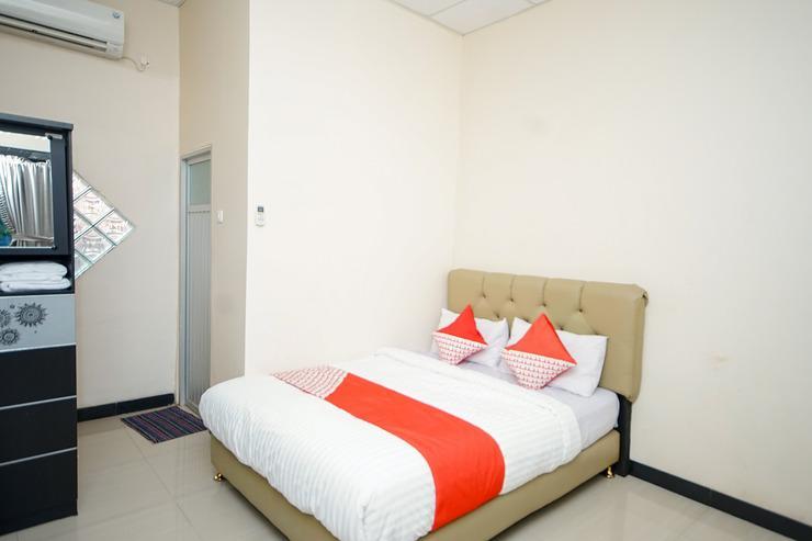 OYO 247 Wisma Merdeka Syariah Palembang - Bedroom