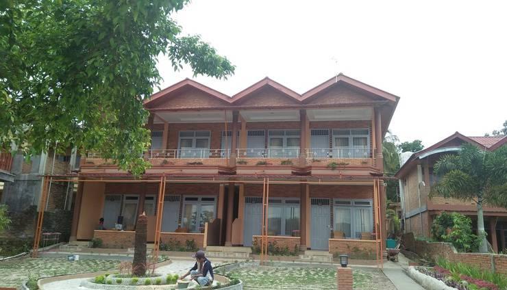 Tamado Cottages Samosir - Exterior