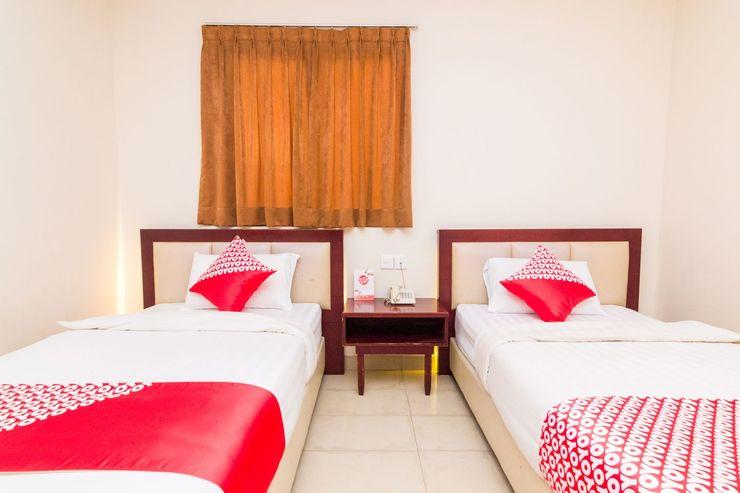 OYO 1447 Lovina Inn - Nagoya Batam Batam - Bedroom