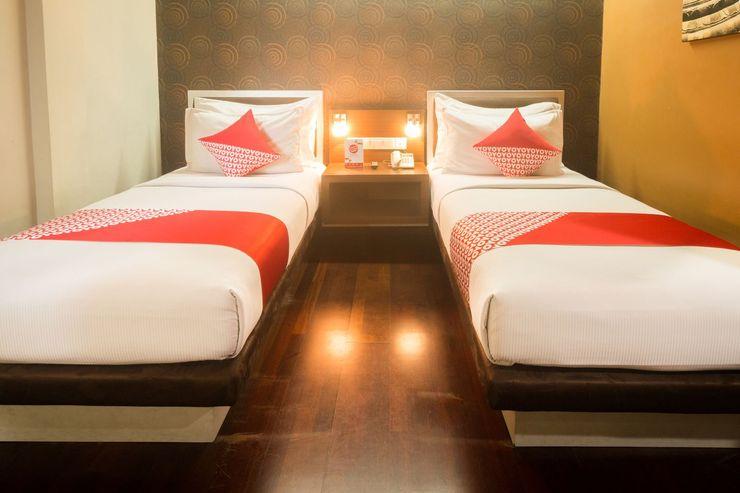 OYO 1089 Hotel Hero Ambon - Bedroom