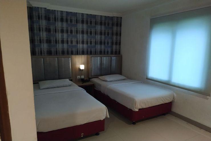 OYO 1273 Hotel Belvena Palembang - Bedroom