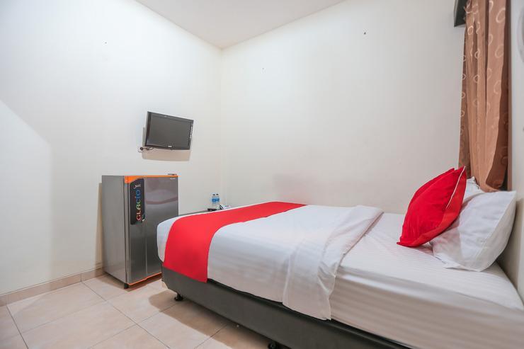 OYO 122 Oekude Residence Jakarta - Bedroom