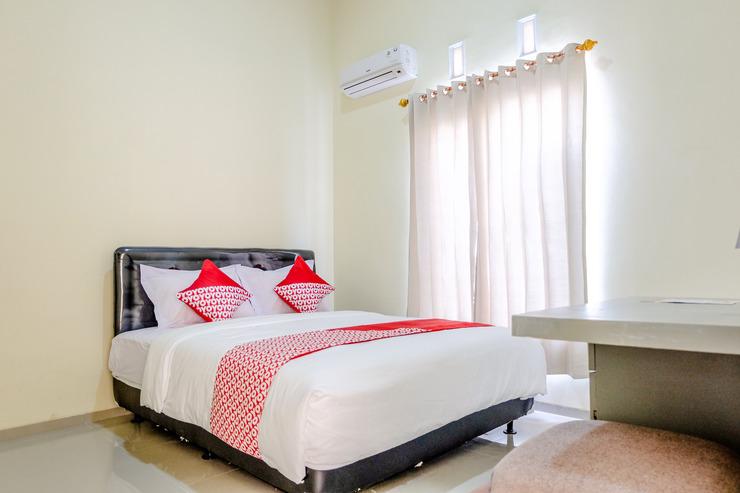 OYO 1165 Cakalang Residence Syariah Malang - Bedroom