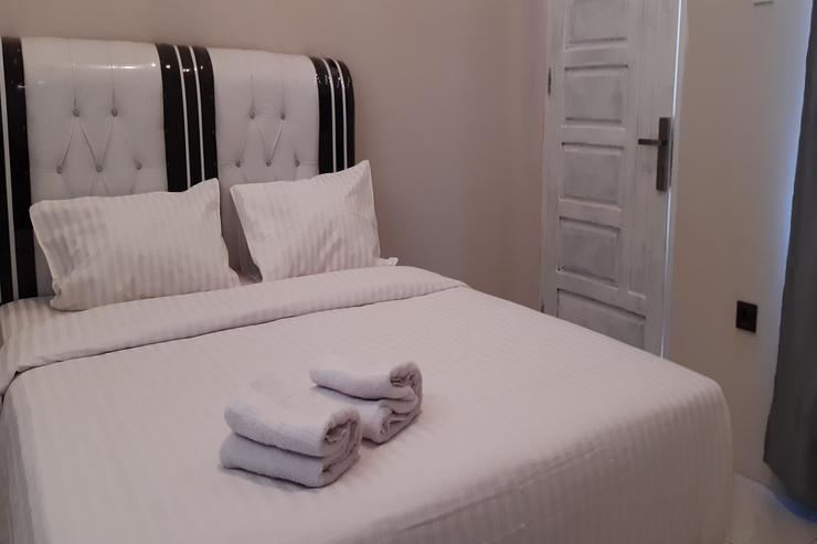 OYO 3266 Alifah Residence Syariah Padang - Bedroom