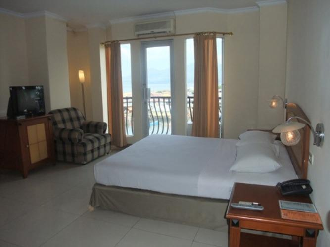 NIDA Rooms Kompleks Pelabuhan Manado - Kamar