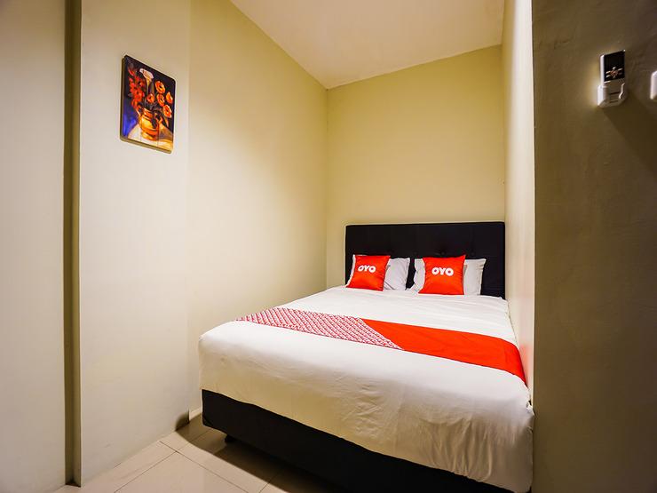 OYO 1769 Rid's Hotel Manado - Bedroom