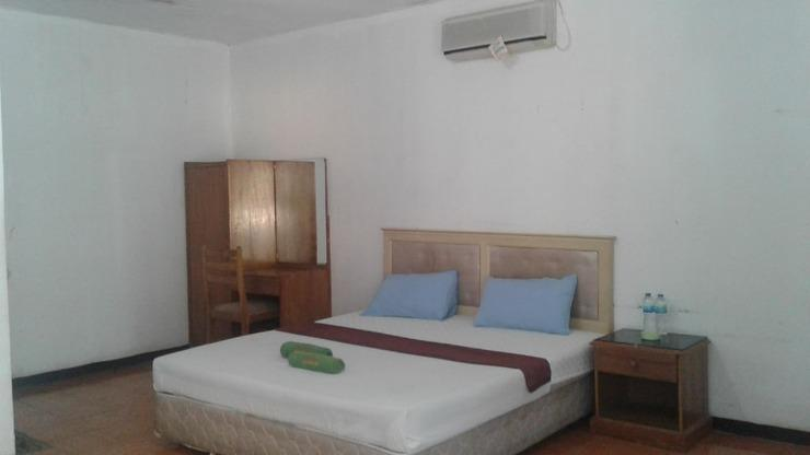 Hotel Cleopatra by MyHome Hospitality Sukabumi - Bedroom