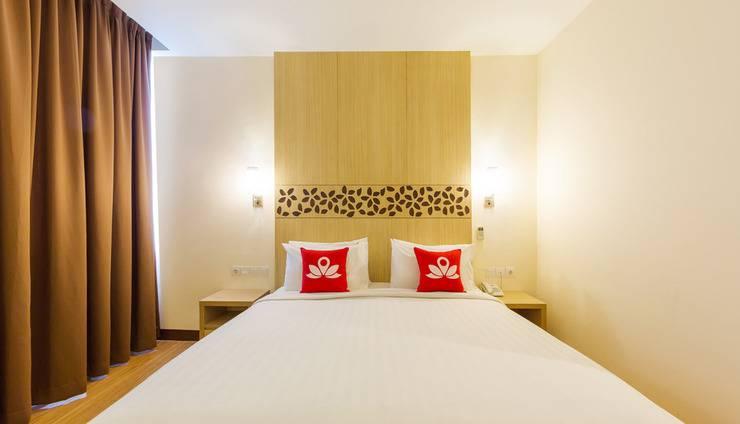 ZenRooms Kuta Tuban Suites - Tampak tempat tidur double