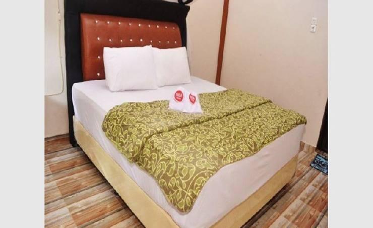NIDA Rooms Besar Orang Utan Langkat - Kamar tidur