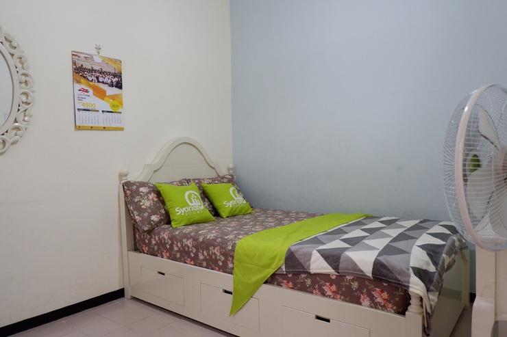 Homey Homestay Syariah Malang - bedroom