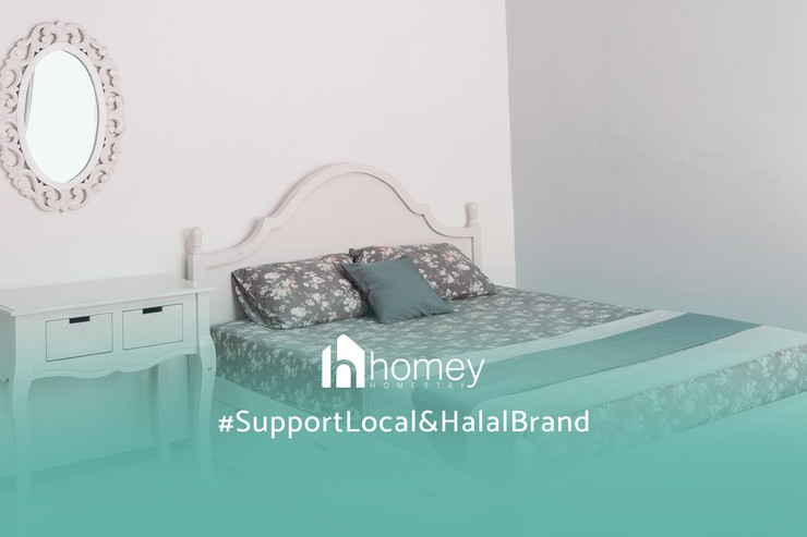 Homey Homestay Syariah Malang - Kamar Tidur