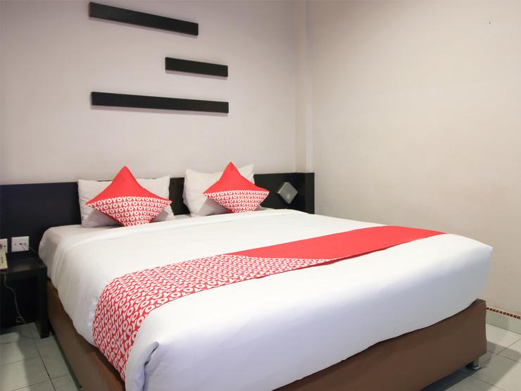 OYO 717 Hotel Dharma Utama Syariah Pekanbaru - Bedroom