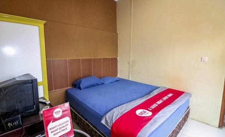 NIDA Rooms Sentalu Heritage Jogja - Kamar tamu