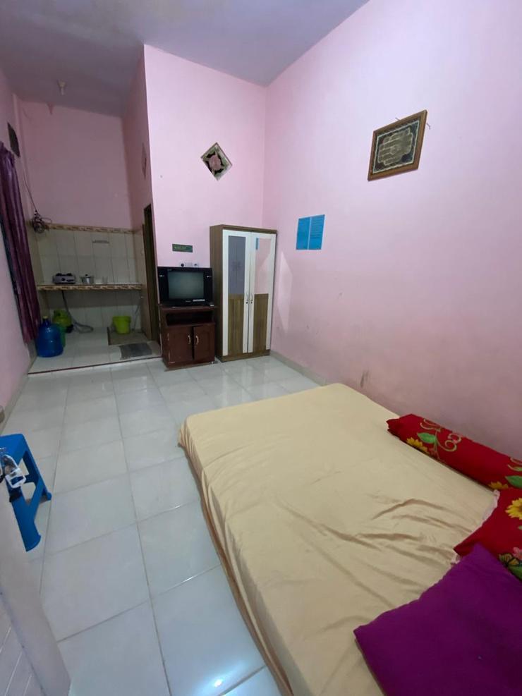Suci Guest House 1 Makassar - kamar tidur
