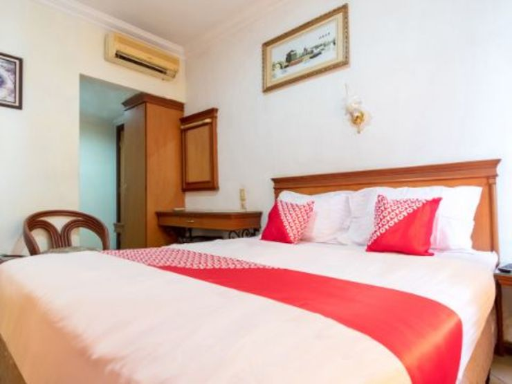 OYO 487 Gajah Mada Hotel Medan - Bedroom