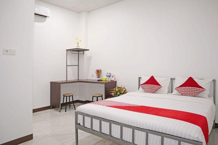 OYO 1306 Cendrawasih Homestay Padang - Bedroom