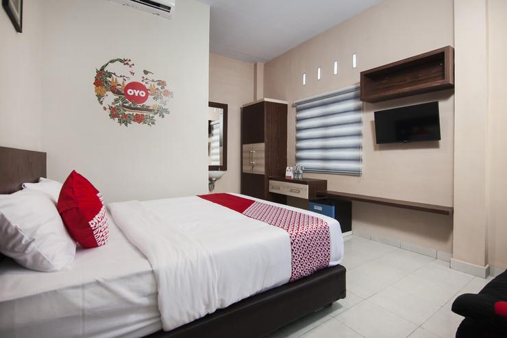 OYO 725 My Arm Home & Stay Medan - Bedroom