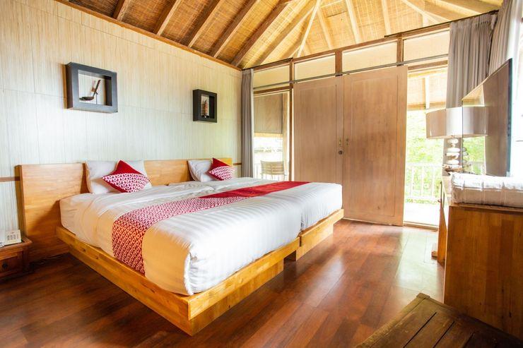 OYO 1215 Tree House Villa Bali - Bedroom