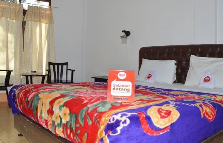 NIDA Rooms Kolam Renang Berastagi - Kamar tidur
