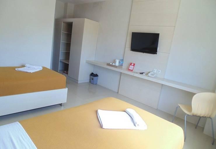 NIDA Rooms Manado Martadinata Manado - Kamar tamu