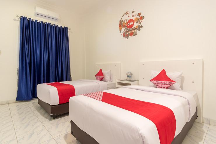 OYO 471 Taj Residence Syariah Medan - deluxe twin bedroom