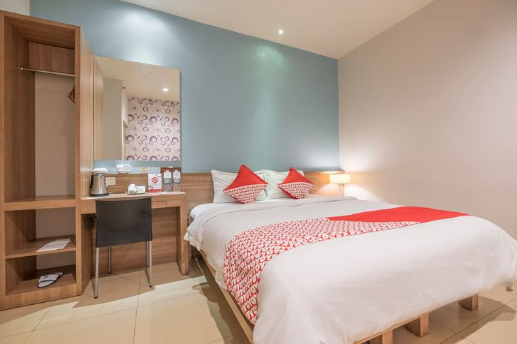 Capital O 1276 Hotel Aswin Makassar - Bedroom