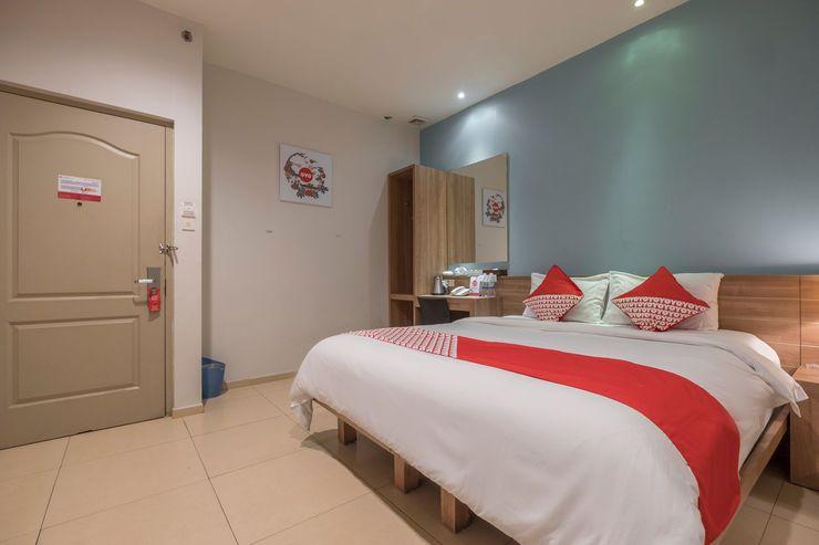 Capital O 1276 Hotel Aswin Makassar - Bedroom
