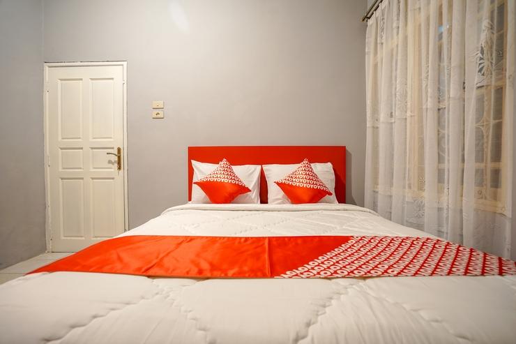 OYO 1026 Cendrawasih Homestay Palembang - Bedroom