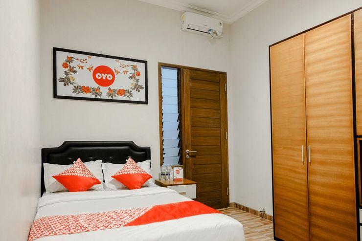 OYO 1023 Junggo Tentrem Malang - Bedroom